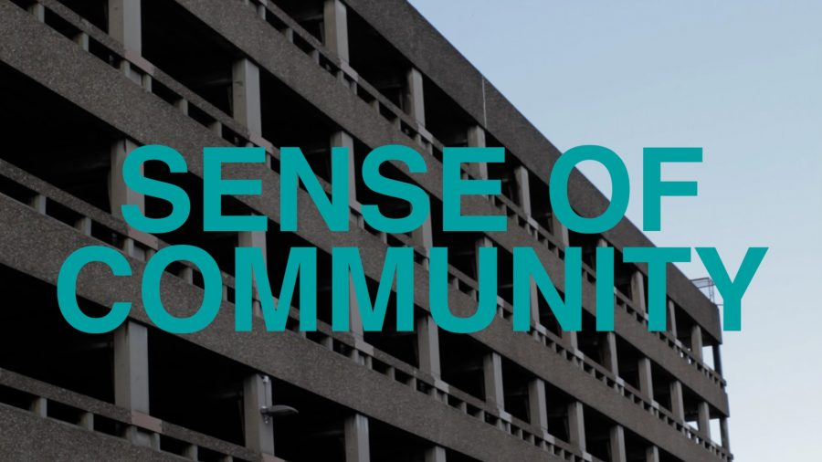 A photograph of a concrete car park with the words 'Sense of Community' in large, blue capital letters.