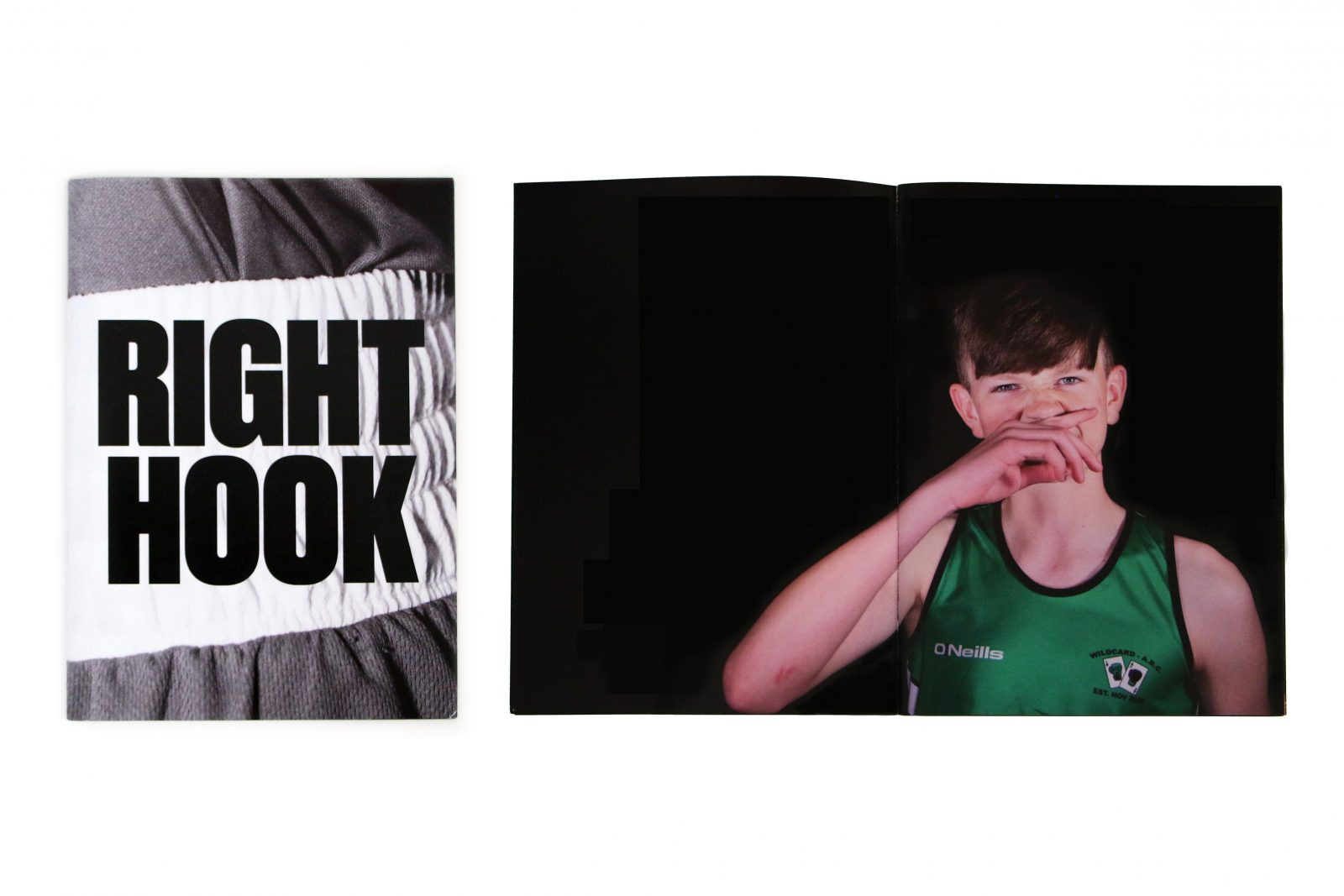 A black and white image reading 'RIGHT HOOK' in black text. An image of a young person wearing a green sports vest and wiping their mouth with their hand.