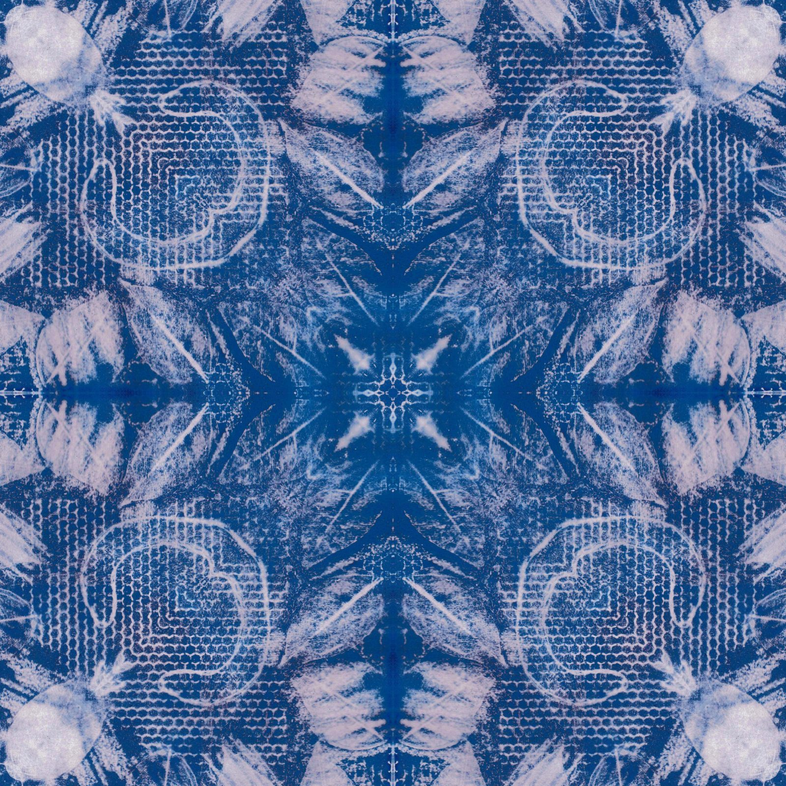 A square blanket decorated with an inky blue design